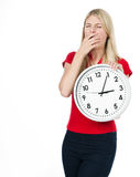 Tired young woman with the clock royalty free stock photography