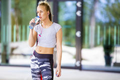 Tired Young Woman Drinking Water After Workout Stock Images