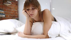 Tired Young Woman Falling Asleep, Lying on Stomach. 4k , high quality stock photos