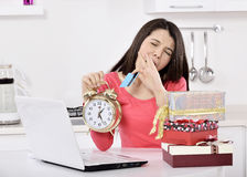 Tired young woman with gift boxes Royalty Free Stock Photo