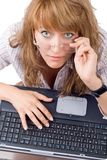 The tired young woman in glasses. Sits with the laptop. Isolated Stock Image