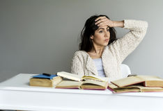 Tired  young woman with headache studying Stock Images