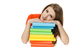 Tired young woman lying on the stack of books Royalty Free Stock Image