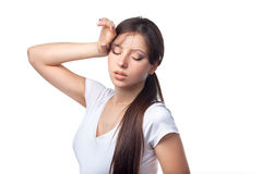 Tired young woman over white background Royalty Free Stock Image