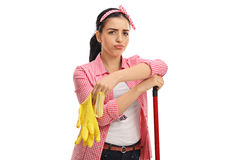 Tired young woman with pair of cleaning gloves and mop Royalty Free Stock Images