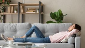 Free Tired Young Woman Relax At Home Sleeping On Cozy Couch Stock Photos - 164678873