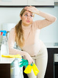 Tired young woman in rubber gloves Royalty Free Stock Images