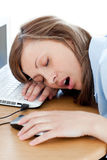 Tired young woman sleeping in her office royalty free stock images
