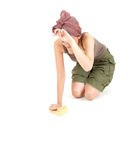 Tired young woman with sponge cleaning floor Royalty Free Stock Images