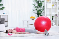 Tired young woman taking rest after exercising Stock Images