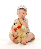 Tiredly boy. Sitting boy with bear Royalty Free Stock Image