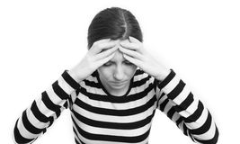 Tiredness. Young brunette woman looking depressed isolated on white background Stock Photos