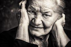 Tiredness. Portrait of a beautiful senior woman royalty free stock image