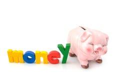 Tirelire avec de l'argent de mot Image stock