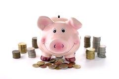 Tirelire et pièces de monnaie Photo stock
