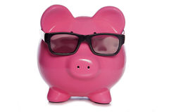 Tirelire portant les lunettes 3D Image libre de droits