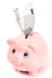 Tirelire rose de porc d'isolement Photos stock