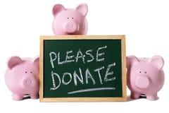 Tirelires avec le message de charité Image libre de droits