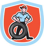 Tireman Mechanic With Tire Cartoon Shield Royalty Free Stock Photo