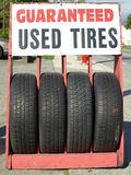 Tires. Guaranteed used tires on the street Royalty Free Stock Photography