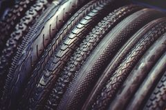The tires on the bicycle wheel are in a row. selling a piece of mountain bike tires in closeup royalty free stock images