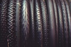 The tires on the bicycle wheel are in a row. selling a piece of mountain bike tires in closeup stock photography