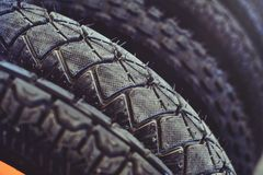 The tires on the bicycle wheel are in a row. selling a piece of mountain bike tires in closeup royalty free stock image
