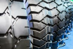 Tires are big truck, tractor or bulldozer. Background of tyre stock images