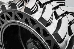 Tires are big truck, tractor or bulldozer. Background of tyre stock image