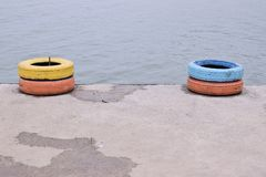 Tires for boat on the beach royalty free stock image