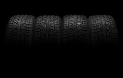 Tires. Car tires over black background stock image