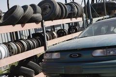 Tires And Car At Scrap Yard Royalty Free Stock Photography