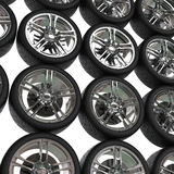 Tires with chrome rims background Royalty Free Stock Photo