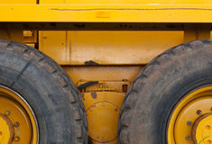 Tires on construction vehicle. Details of tires and wheels on a large, heavy construction vehicle Stock Image