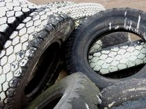 Tires. Discarded tires. Shop, useless. Much of the land pollution. Poor processing. Dropping self-esteem. Wasting natural. Binge consumption. The bad economic royalty free stock images