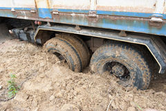 Tires down into the mud stock images