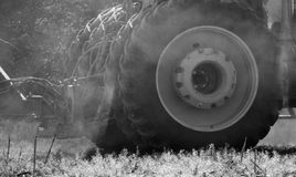 Tires and Dust. It was a bit dusty in the field, as the tractor planted soybeans. The dust curled around the tires Stock Photography
