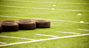 Tires On Football Field Stock Image
