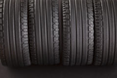 Tires. Four tires on black background stock photo