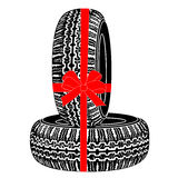 Tires gift tied with red ribbon Stock Photography