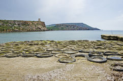 Rubber tires coast. Rubber tires found at the coastline at Golden Sands Bay on the Maltese islands Stock Image