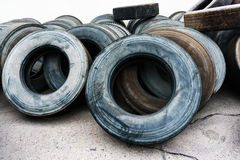 Tires heap on cement ground, used car tires Stock Images