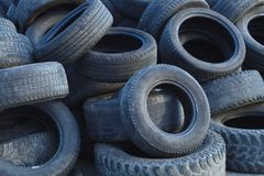 Tires heap recycling dump waste old rubber automobile waste. Tires for recycling used scrap rubber waste stock image