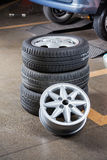 Tires And Hubcaps At Auto Repair Shop Stock Photos