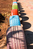 Tires on kids playground Stock Image