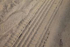 Tires marks on sand, wheels on ground road stock photography