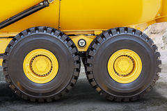 Tires of mining truck on the mining site Stock Images