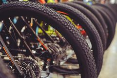 Free Tires Mountain Bike Wheel Rear End Stand In A Row. Part Of The Mountain Bike Is A Tire In Close Range Royalty Free Stock Photos - 111570058