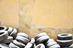 Tires near the wall Royalty Free Stock Photography