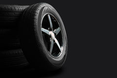 Tires. New tires are close to each other on an isolated dark background stock images